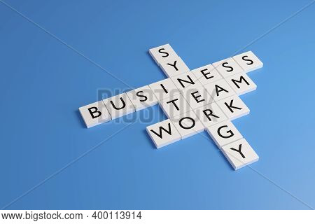 White Chips With Letters Form The Words Synergy, Business, Team And Work On A Blue Background. 3d Il