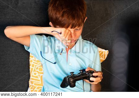 Concept Of Eye Strain Due To Over Night Video Game Play - Teenager Kid Playing Video Game During Lat