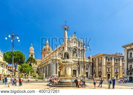 Italy, Catania, May 13, 2018: People Tourists Near Elephant Statue Fountain And Cathedral Of Santa A