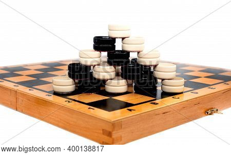 A Board For Playing Checkers. Board Game Of Checkers. Checkers On A White Background