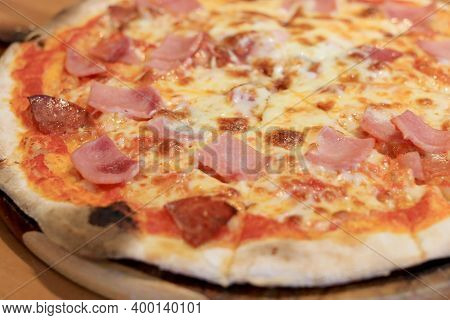 Sliced Cheesy Pizza On Wooden Cutting Board.delicious Italian Food Delivered In Cardboard Box For Lu