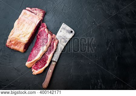 Sirloin Steak, Uncooked Beef Meat, On Black Background, Top View, With Copy Space For Text