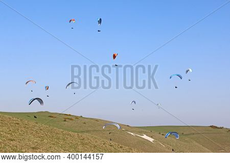 Paragliders Flying At Milk Hill White Horse, Wiltshire