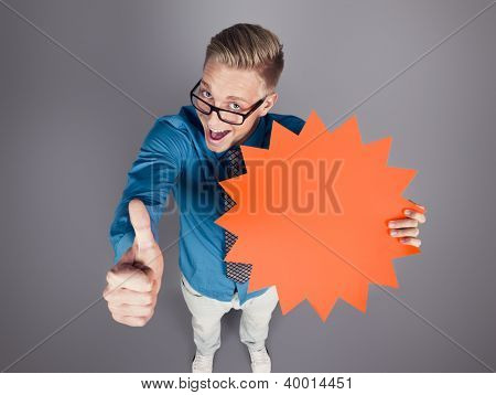 Excellent offer: Happy salesman giving thumbs up while holding empty sign with space for text promoting sales,  isolated on grey background.