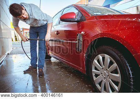 Contactless Car Wash Self-service. Man Washing Car