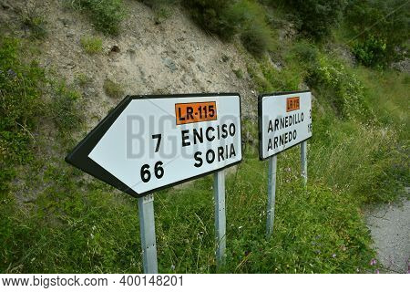 Signage At A Road Junction In Peroblasco To Go In Different Directions. Distance In Kilometers To So