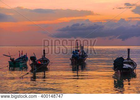 Traditional Thai boats near the beach at sunset time. Nai Yang beach. Phuket. Thailand