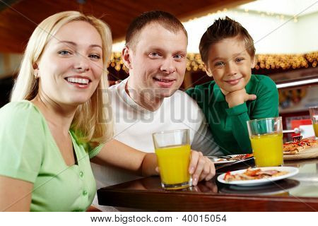 Portrait of a happy family having lunch at the cafe