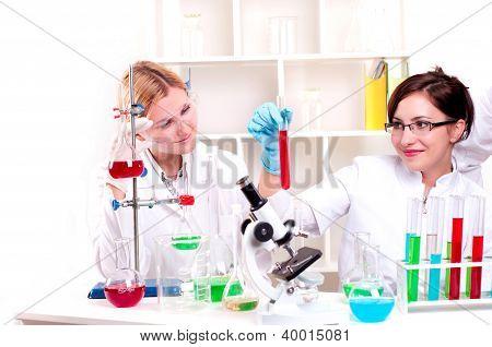 portrait of a beautiful woman chemist