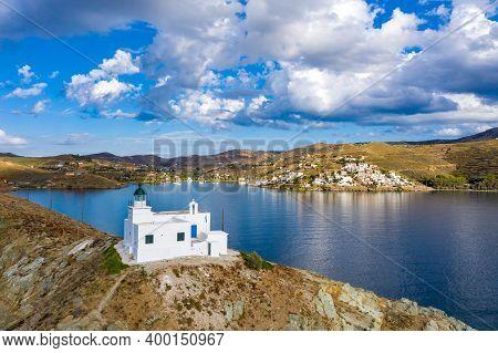Greece, Kea Tzia Island. Lighthouse On Rocky Cape, Sky, Sea Background.