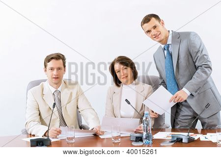group of business people discussing documents