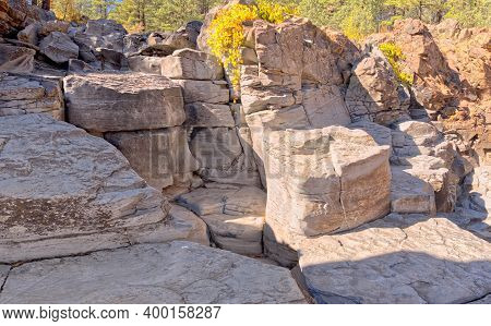 The Blocky Cliffs Of Sycamore Falls In The Kaibab National Forest Near Williams Arizona. The Waterfa