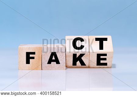 Wooden Cubes Are Turned Over For Change Wording From Fake To Fact.