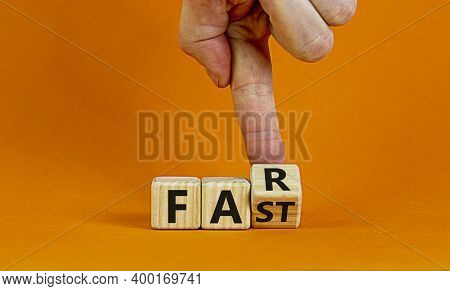Alone And Fast Or Together And Far. Male Hand Turns Cubes And Changes The Word 'fast' To 'far' On A