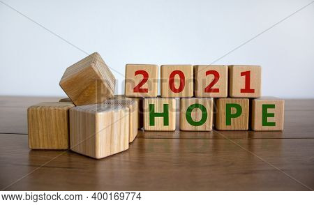 Symbol Of Planning 2021. Wooden Cubes With Words 'hopes 2021'. Beautiful Wooden Table, White Backgro