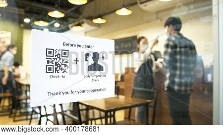Check In And Body Temperature Check Paper Sign Measure In Front Of Restaurant With Staff Scan Body T