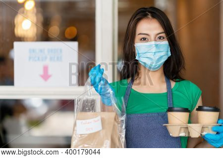 Portrait Young Woman Worker Wearing Face Surgical Mask Holding Takeout Coffee And Food Paper Bag - R