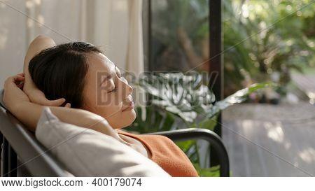 Asian Woman Resting Breathing Fresh Air Feeling Mental Balance Enjoying Wellbeing At Home On Sofa, C