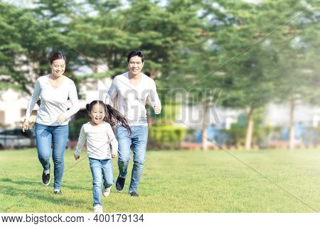 Young Attractive Happy Asian Family Playing By Running Together In Outside Nature Park In Home Schoo
