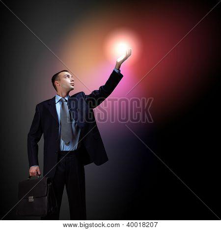 Businessman with light shining