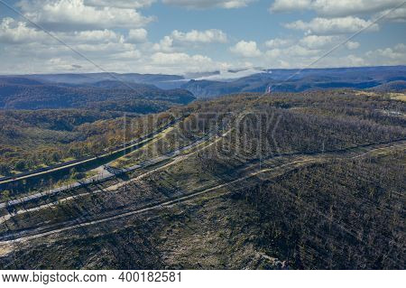 Aerial View Of Low Clouds In A Valley Of Forest Regeneration After Bushfires In The Blue Mountains I