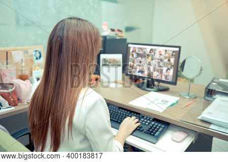 Business Women Are Using Computer Laptop For Online Meetings With Video Call Program. Concepts Of Co