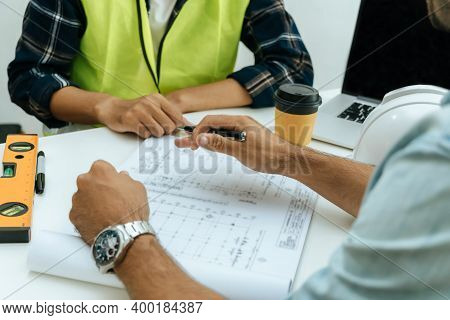 Engineer, Architect, Construction Worker Team Working And Planning On Drawing Blueprint On Workplace