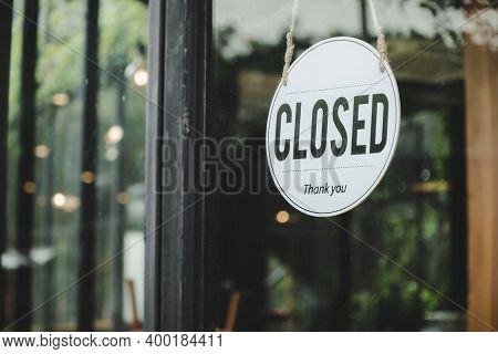Close. Coffee Cafe Text On Vintage Sign Board Hanging On Glass Door In Modern Cafe Coffee Shop, Reop