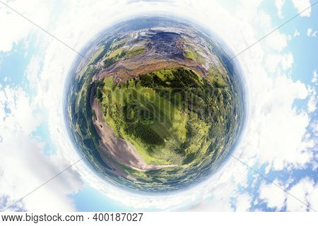 Aerial landscape with coal mine. Environmental disaster - a coal mine dump landslide destroyed a river valley. Little planet pano