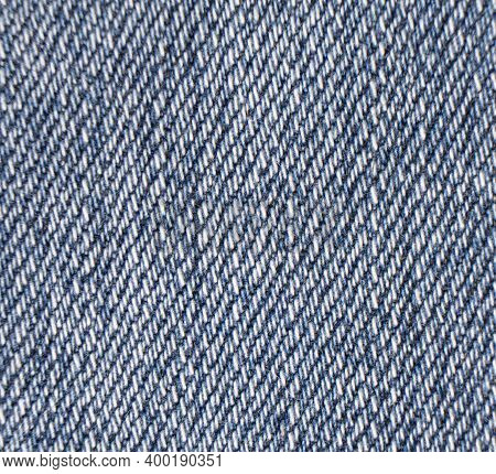Macro Shot Blue Jeans Fabric Texture Background. Denim Jeans Texture. Closeup Texture And Pattern Of