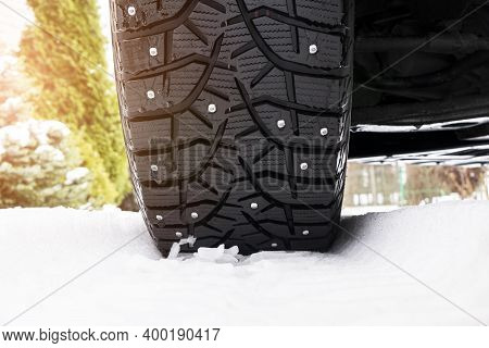 Car Tire In The Snow Close Up. Car Tracks On The Snow. Traces Of The Car In The Snow. Winter Tires.