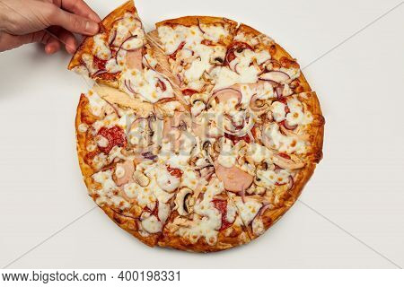 Mans Hand Takes A Delicious Slice Of Pizza With Margarita Or Margarita With Mozzarella Cheese, A Man