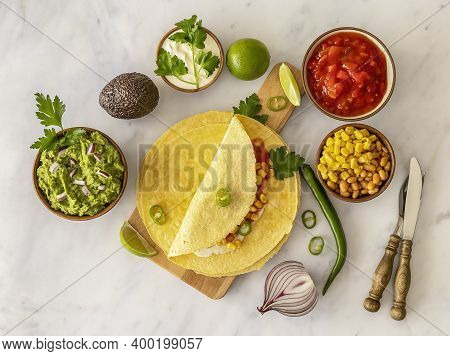 Tortilla Wrap Or Burrito With Corn, Beans, Greens, And Homemade Guacamole. Vegetarian Healthy Food,