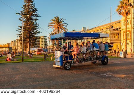 Adelaide, South Australia - March 18, 2017: Glenelg Pedal Bar With People Having Fun On The Move At