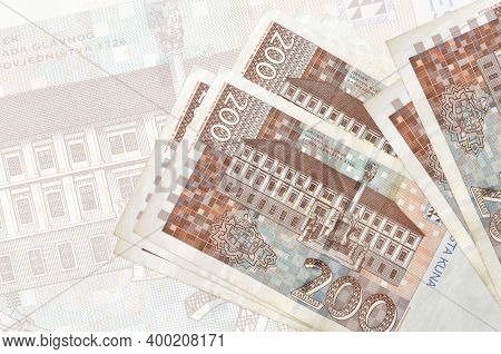 200 Croatian Kuna Bills Lies In Stack On Background Of Big Semi-transparent Banknote. Abstract Prese