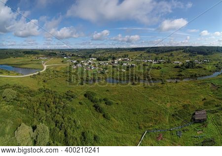 Aerial landscape with Siberian village on small river