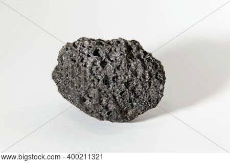 Fragment Of Black Volcanic Lavage With Vacuoles Through Which The Gases Escaped, Very Light, The Min