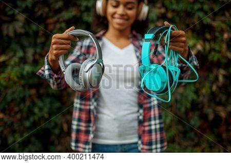 Music fan in headphones listening to music in park