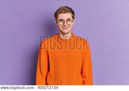 Portrait Of Handsome European Male Student Has Gentle Smile On Face Happy To Hear Pleasant News Stan