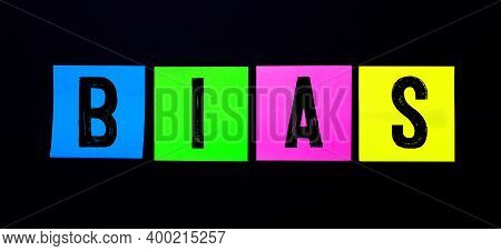 On A Black Background, Bright Multicolored Stickers With The Word Bias
