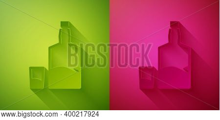 Paper Cut Tequila Bottle And Shot Glass Icon Isolated On Green And Pink Background. Mexican Alcohol