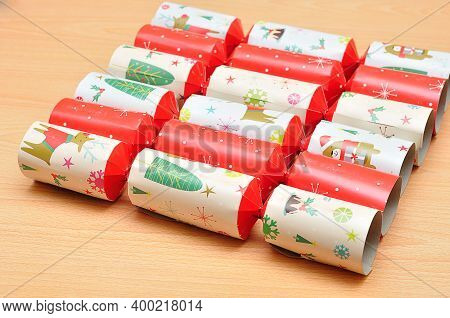 Row Of Colorful Christmas Crackers On A Table