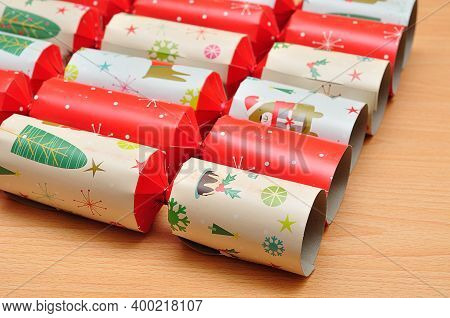Close Up Of Colorful Christmas Crackers On A Table