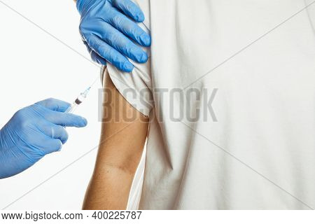 Making Injection Of Vaccine In Shoulder White Background