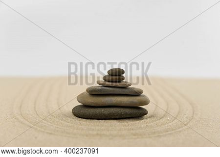 Zen Sand Garden Meditation Stone Background With Copy Space. Stones And Lines Drawing In Sand For Re