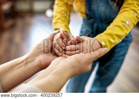 I Care About You. Close Up Shot Of Grandmother Holding Hands Of Her Little Granddaughter While Spend