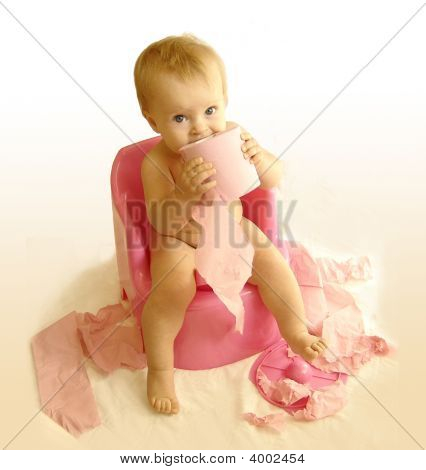 The Kid Sits On A Pot With A Toilet Paper
