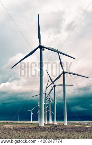 Wind Turbines Generating Electricity In A Stormy Weather