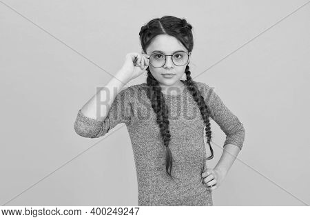 Choosing Trendy Glasses Perfect For Her Style. Little Child Wear Eyeglasses Yellow Background. Small