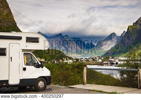 Camper Car Motor Home And Fjord Landscape With Reine Village In Summer, Lofoten Norway. Camping On N